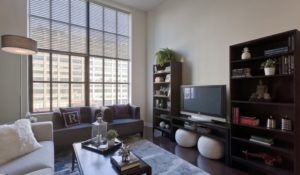 Living room apartment for rent in Center City with large window and Philadelphia view